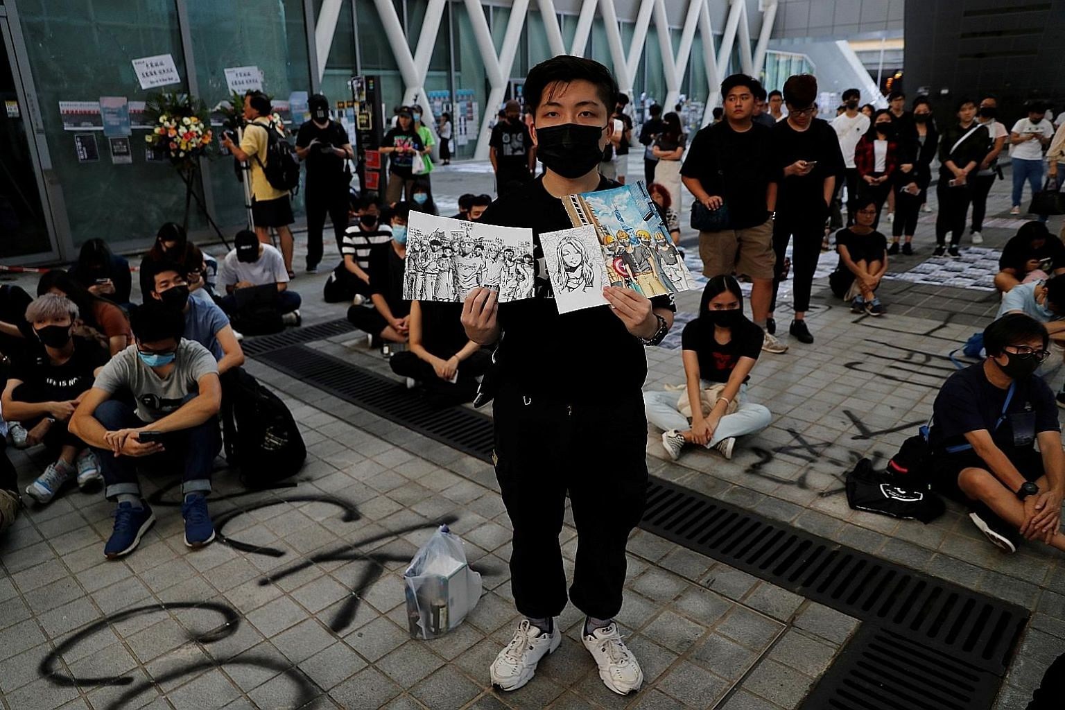 An anti-government protester making a stand with drawings during a Hong Kong demonstration yesterday. PHOTO: REUTERS