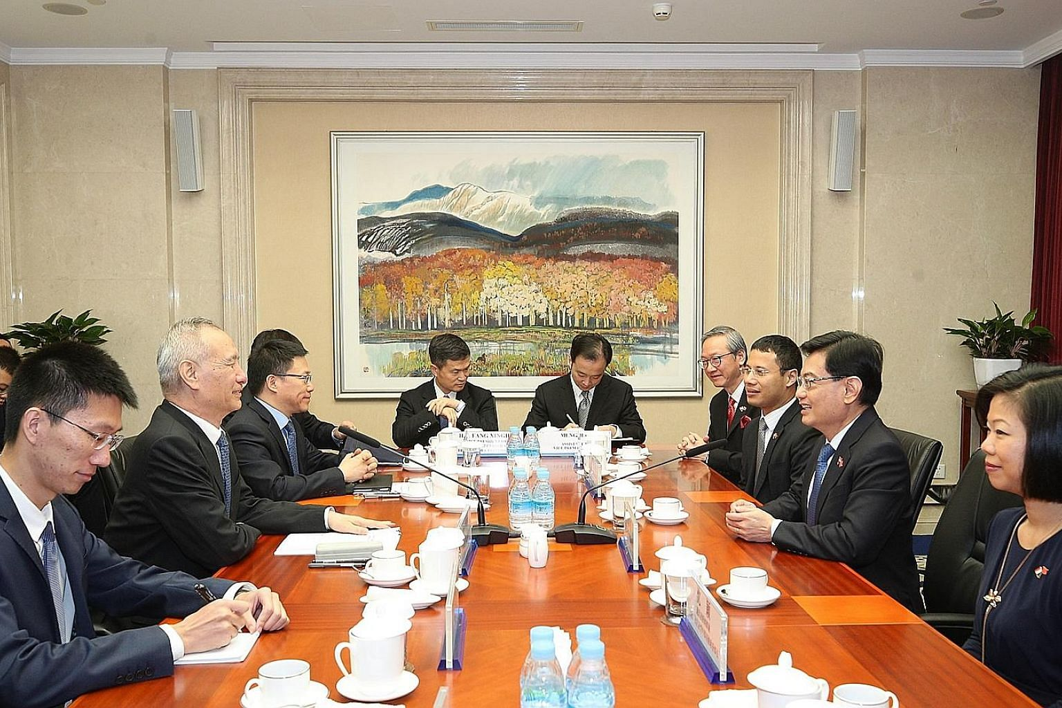 Deputy Prime Minister Heng Swee Keat holding talks with Chinese Vice-Premier Liu He (second from far left) in Beijing yesterday. With Mr Heng are (from right) Senior Minister of State for Communications and Information, and Culture, Community and You