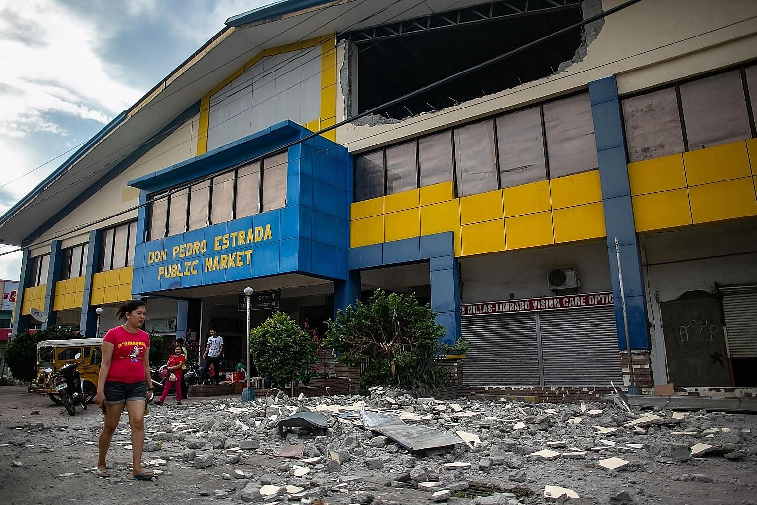 Debris from a partially damaged building in the city of Digos in Davao del Sur province on the southern Philippine island of Mindanao yesterday, after a 6.4-magnitude earthquake struck the Mindanao region on Wednesday night. The authorities said five