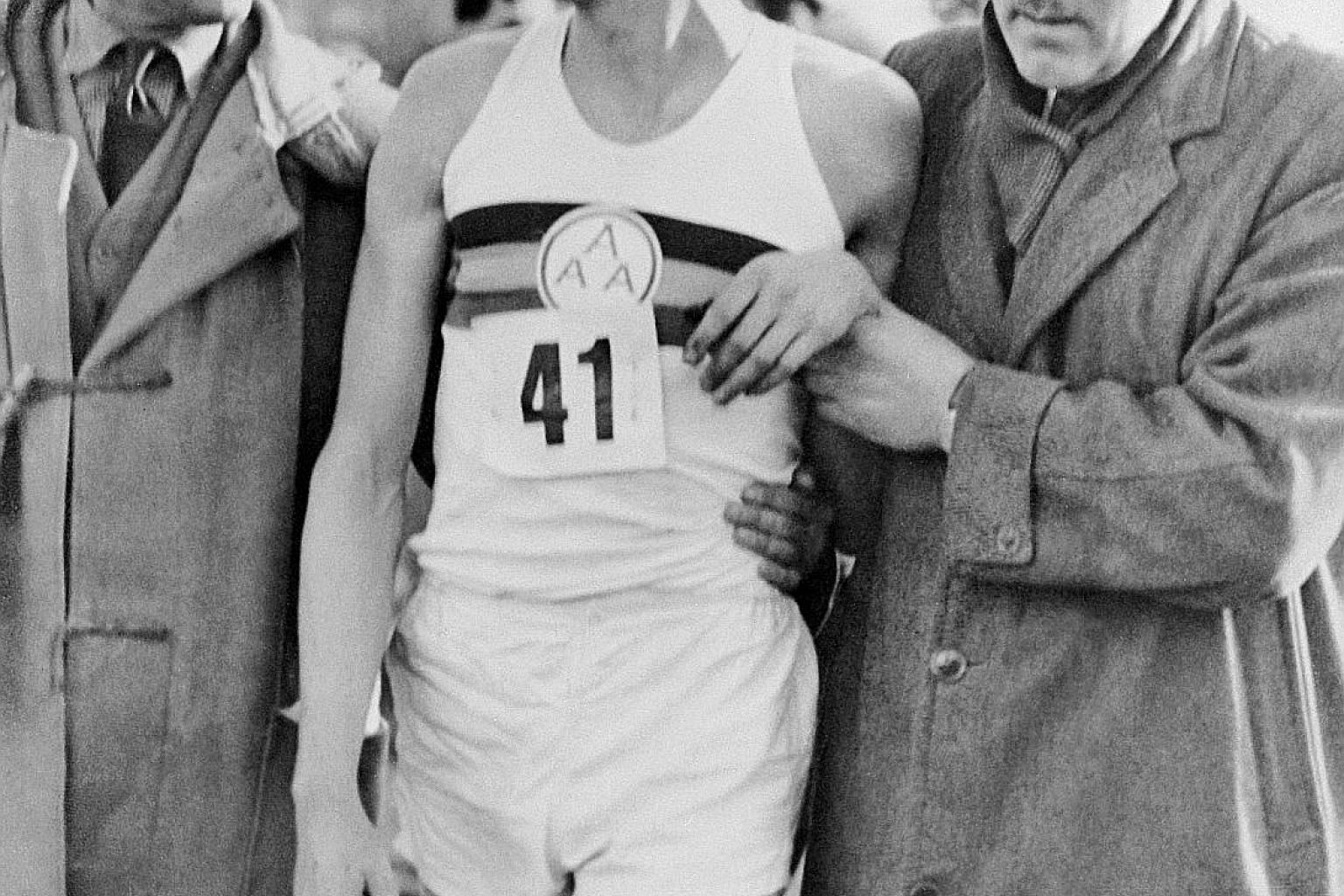 Briton Roger Bannister being helped by two officials after breaking the mile (1,609m) world record at Iffley Road Track in Oxford on May 7, 1954. The medical student clocked 3min 59.4sec to shatter the psychological ceiling of four minutes.
