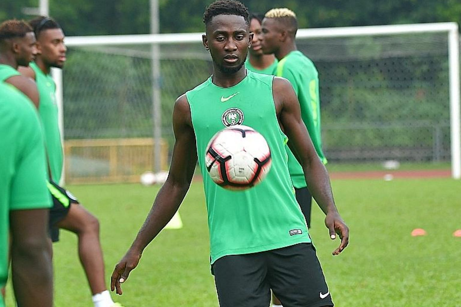 Wilfred Ndidi training with his Nigerian teammates at Bukit Gombak Stadium before their friendly against Brazil. The tough-tackling midfielder has played a key role in Leicester's fine start to the season.