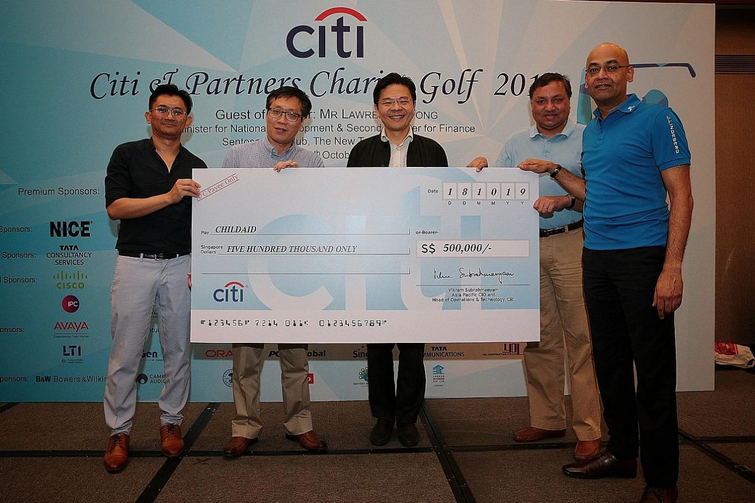 (From left) ChildAid 2019 co-chair Helmi Yusof, Business Times editor Wong Wei Kong, National Development Minister Lawrence Wong, Citi's chief information officer and head of operations and technology for Asia-Pacific Vikram Subrahmanyam and Citi's h