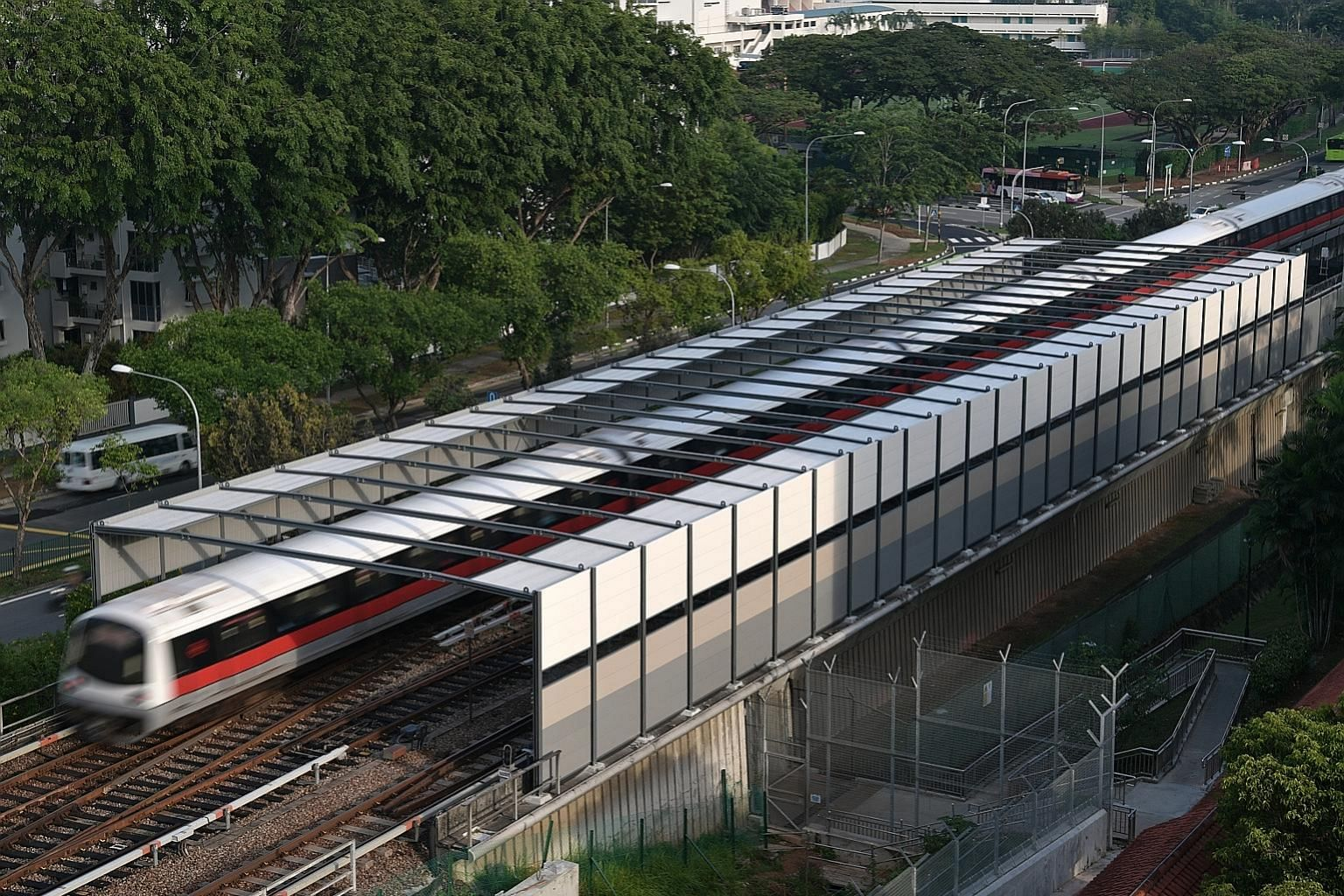 """Recently installed railway noise barriers that have a semi-enclosed """"portal"""" design to handle the higher noise levels at turnout sections, where trains switch tracks, next to Block 503 Ang Mo Kio Avenue 5. ST PHOTO: KUA CHEE SIONG"""