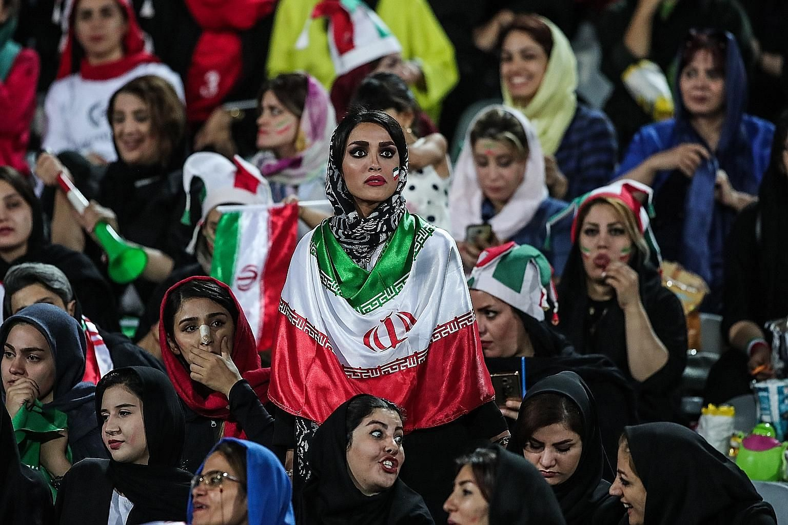 Iranian women attending the World Cup 2022 qualifier between Iran and Cambodia at the Azadi Stadium in Teheran on Oct 10. For the first time since the 1979 Islamic Revolution, women were allowed to attend a football match.