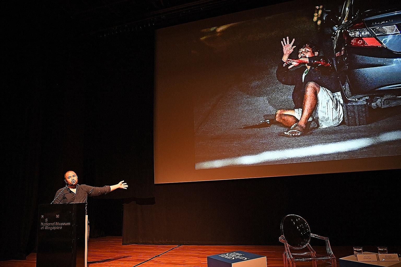 World Press Photo award-winning photojournalist Ezra Acayan from the Philippines talks about his work covering the drug war in his home country at The Straits Times Through The Lens photo festival at the National Museum. ST PHOTO: STEPHANIE YEOW