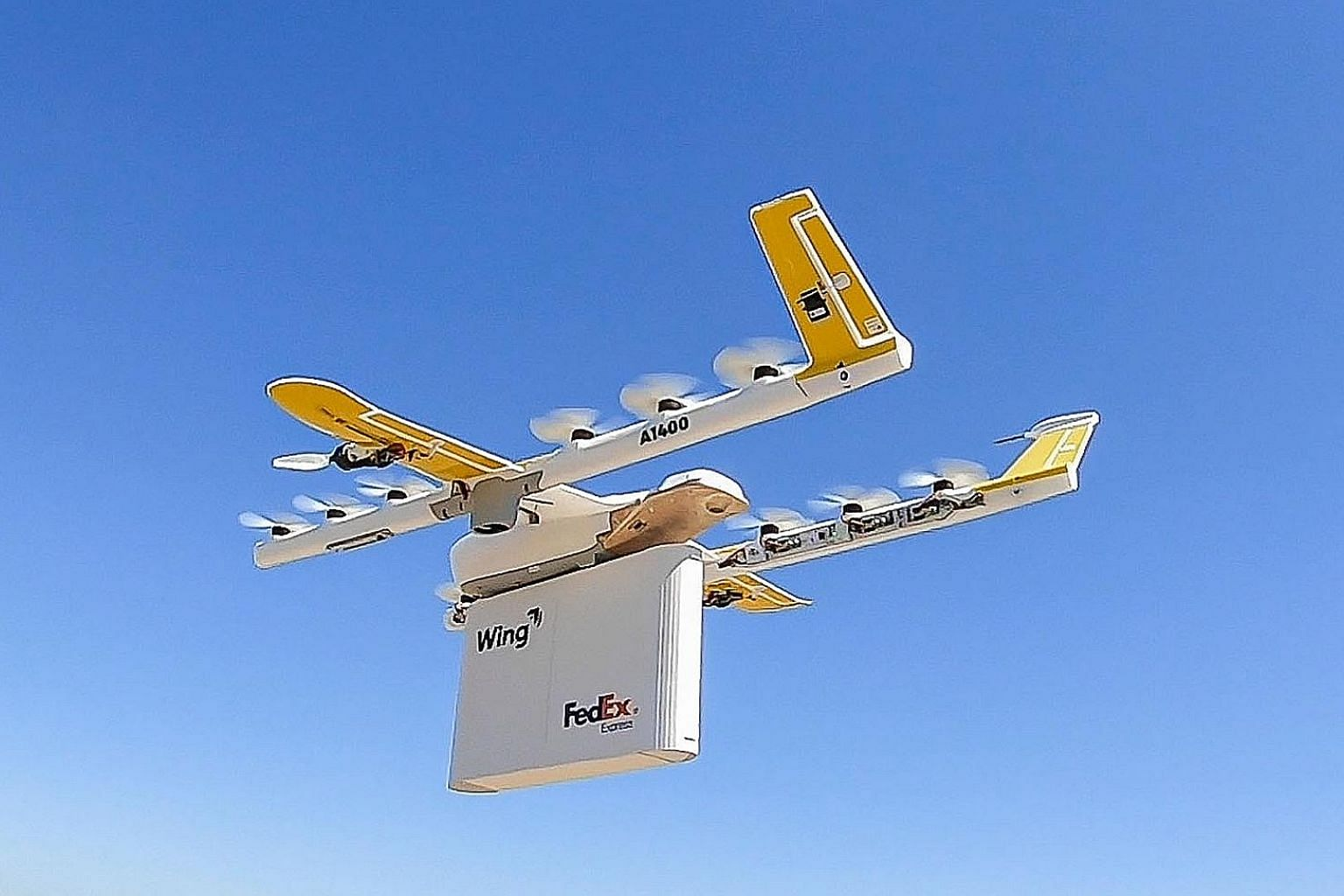Once a drone arrives at its destination, it hovers above the house and lowers the package with a cable.