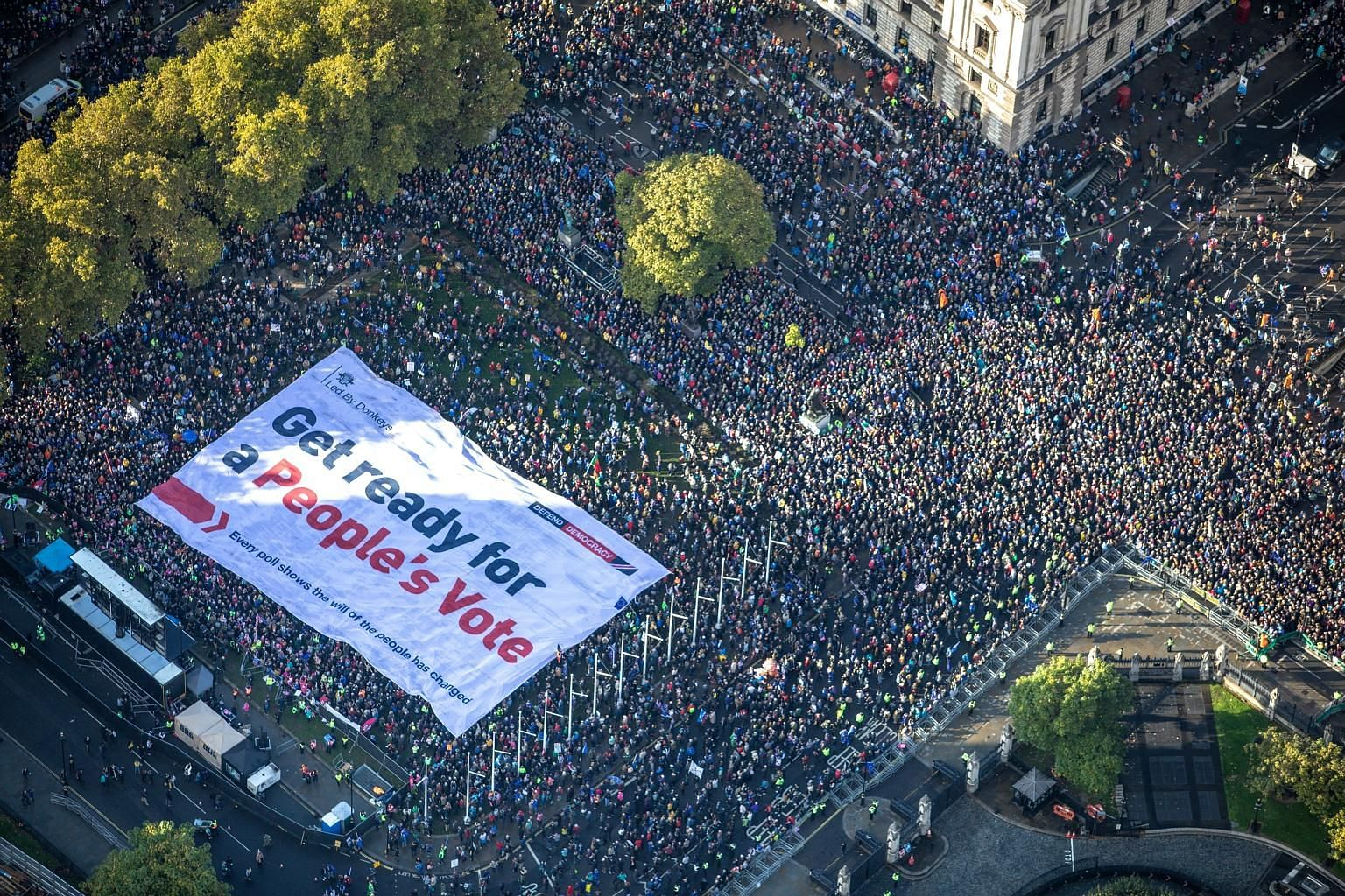 An aerial view of a section of the crowd of thousands who marched to Parliament Square in London on Saturday demanding a people's vote on the Brexit deal. PHOTO: REUTERS