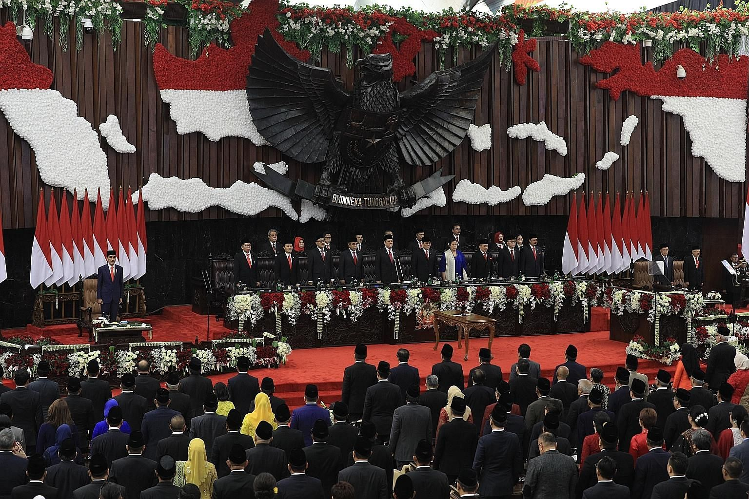 Mr Joko Widodo at the inauguration ceremony for his second term as Indonesian President in Jakarta yesterday. Developing the country's human resources is at the top of his to-do list. PHOTO: MCI Above: President Joko greeting members of the public be