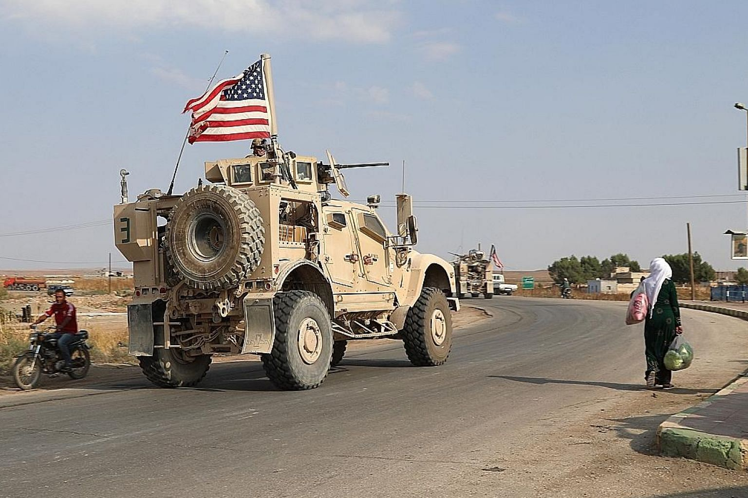 American troops heading towards the Iraqi border in north-eastern Syria on Sunday, as part of a withdrawal announced by President Donald Trump which has been criticised in Washington and elsewhere.