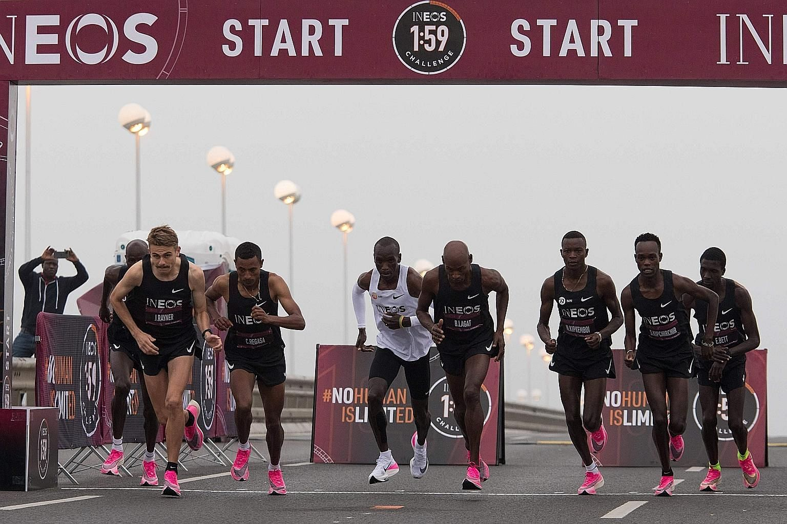 Kenyan marathoner Eliud Kipchoge in the unreleased version of the Nike ZoomX Vaporfly Next%, with his pacers in the pink Next%, starting the marathon that busted the two-hour barrier in Vienna on Oct 12. PHOTO: AGENCE FRANCE-PRESSE
