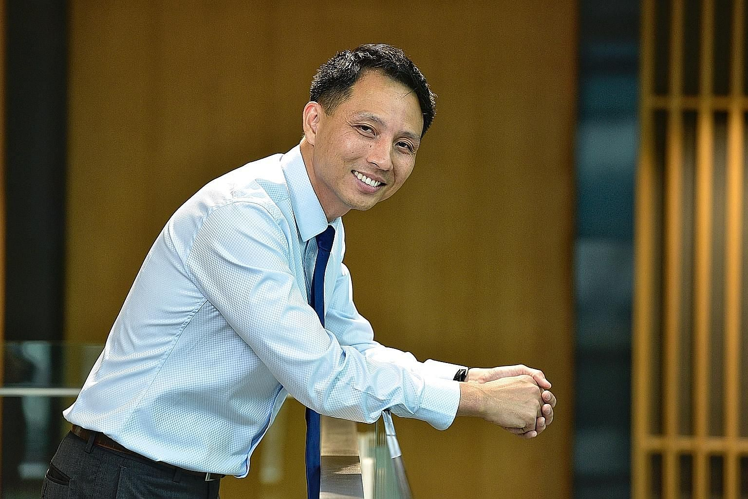 Mr Ng Chia Yong, a deputy regional general manager for CapitaLand's commercial management arm in China, is among eight young bilingual professionals recognised by the Promote Mandarin Council and Business China. ST PHOTO: DESMOND WEE