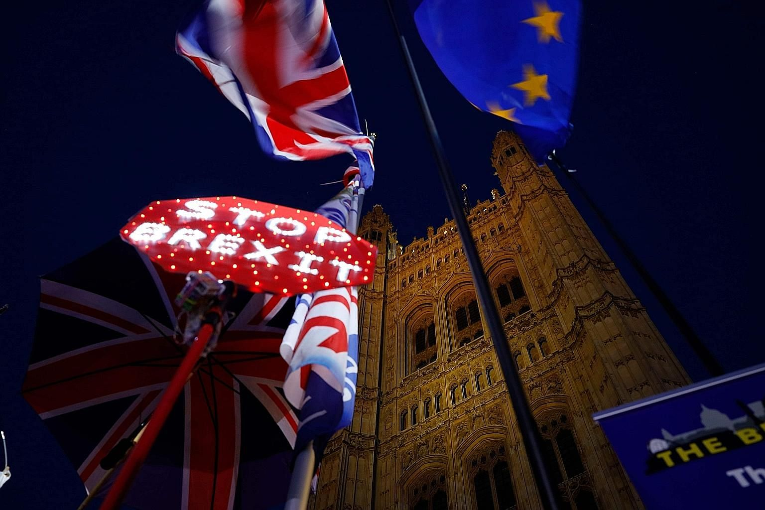 Banners, the Union Jack and EU flag outside the Houses of Parliament in London on Tuesday, as MPs debated the second reading of the British government's European Union Withdrawal Agreement Bill.