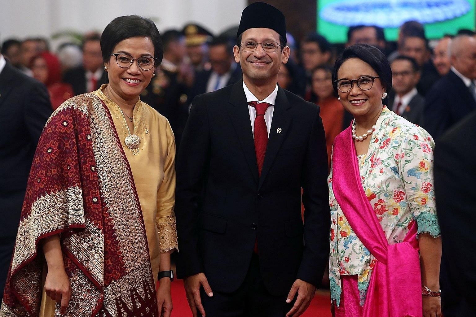Education and Culture Minister Nadiem Makarim with Finance Minister Sri Mulyani Indrawati (far left) and Foreign Minister Retno Marsudi before the Indonesian Cabinet's swearing-in ceremony at Merdeka Palace yesterday.