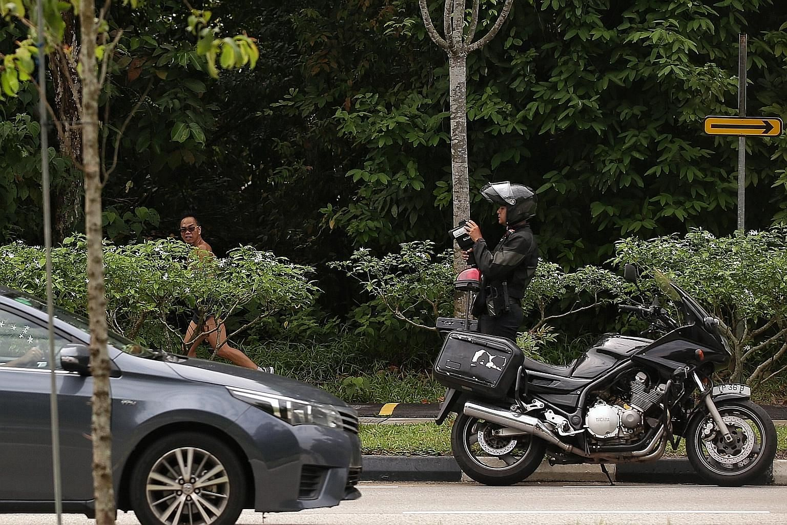 A Traffic Police officer monitoring traffic speed in Mandai Road during an enforcement operation yesterday.