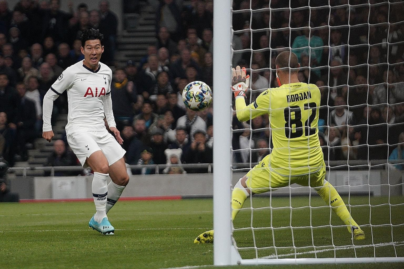 Son Heung-min lashing in Tottenham's second goal in the 5-0 hammering of Red Star Belgrade in the Champions League at the Tottenham Hotspur Stadium on Tuesday night. The win lifted Spurs to second in Group B. PHOTO: EPA-EFE