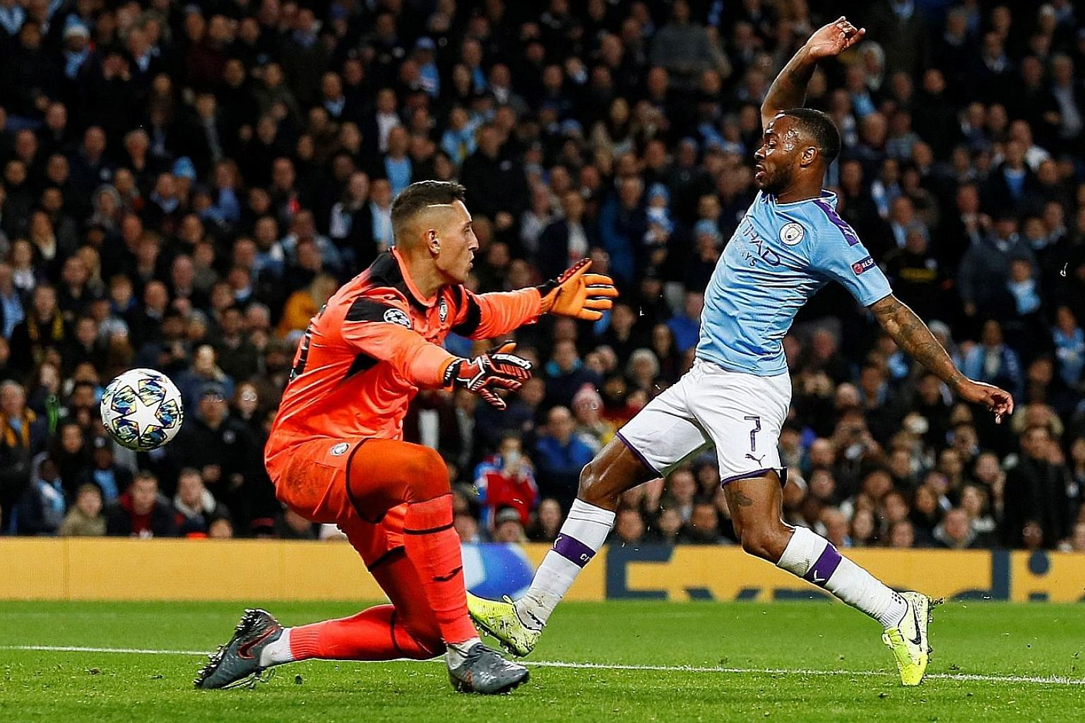 Raheem Sterling scoring Manchester City's fifth goal past Atalanta goalkeeper Pierluigi Gollini to complete his hat-trick in the Champions League game at the Etihad Stadium on Tuesday night. PHOTO: REUTERS