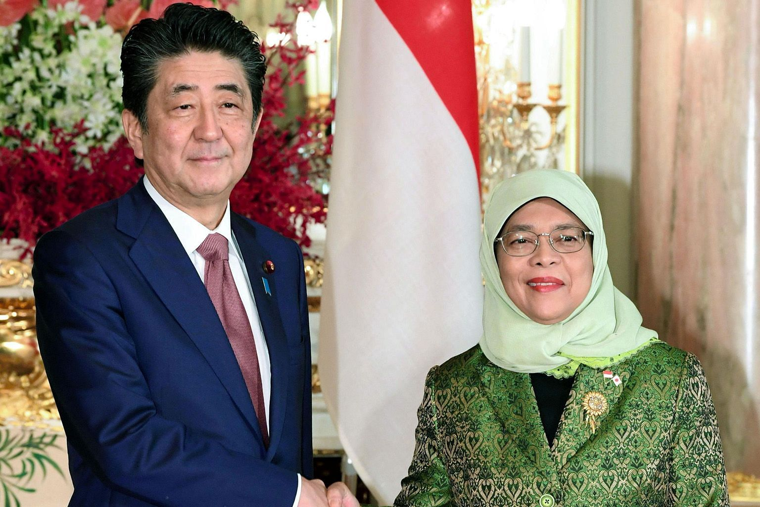 President Halimah with Japanese Prime Minister Shinzo Abe at the Akasaka State Guest House in Tokyo yesterday. Madam Halimah was among the heads of state and royalty from about 180 countries who attended Emperor Naruhito's coronation on Tuesday. PHOT