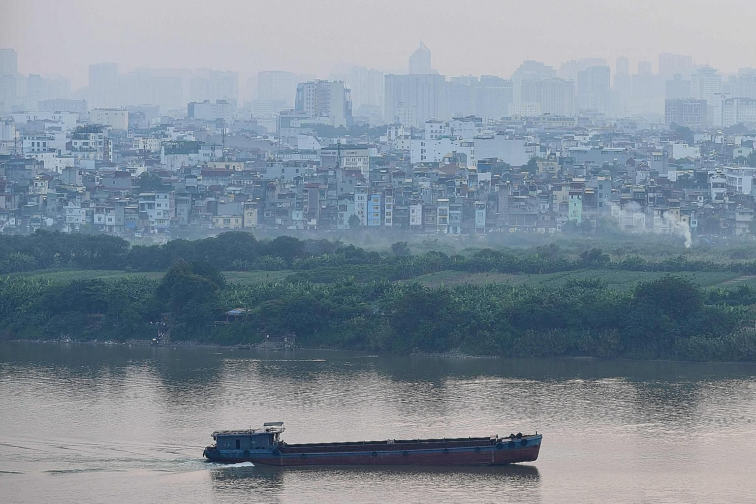 Smog over Hanoi's skyline last month. Vietnam is planning to develop an air quality app with information from state air-monitoring posts - a good prod for firmer action against emissions, says the writer.