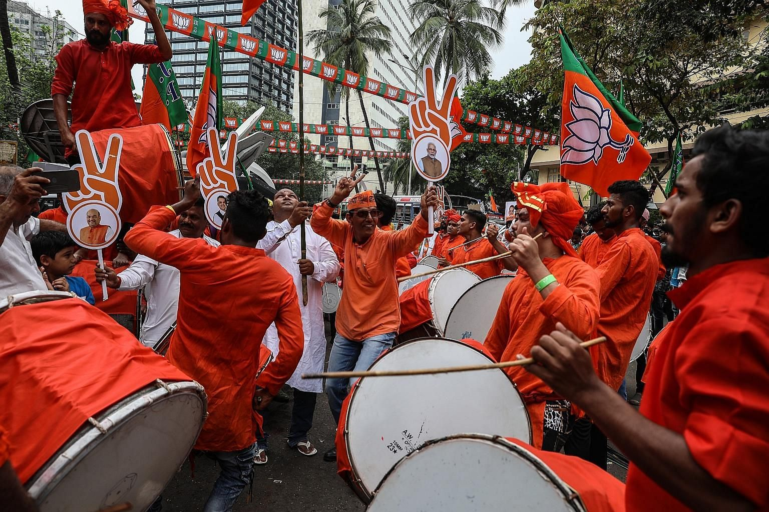 Supporters of India's ruling BJP celebrating their lead in the Maharashtra legislative election outside the party's head office in Mumbai yesterday.
