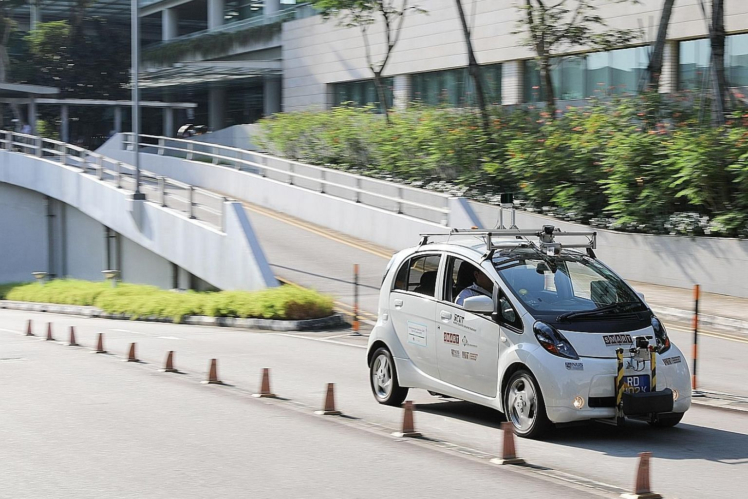 A self-driving electric vehicle by the Singapore-MIT Alliance for Research and Technology being tested on the road at the National University of Singapore. Having access to more public roads would give researchers more scenarios and environments to w
