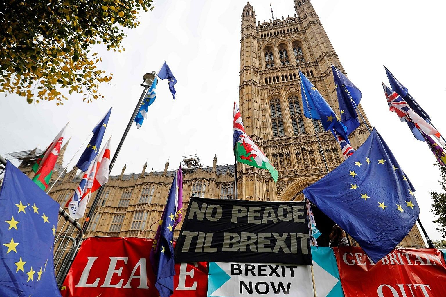 Banners and placards in support of Brexit (top) and against it (above) during protests outside the Houses of Parliament in London on Wednesday. No matter what Prime Minister Boris Johnson decides to do, Britain's links to Europe are unlikely to be re