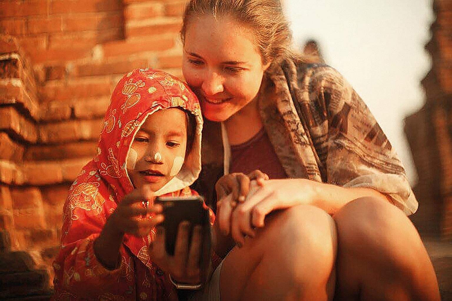 Ms Katrin Nagel (above, with a child in Myanmar) on her experience with meeting fellow solo women travellers on her trips