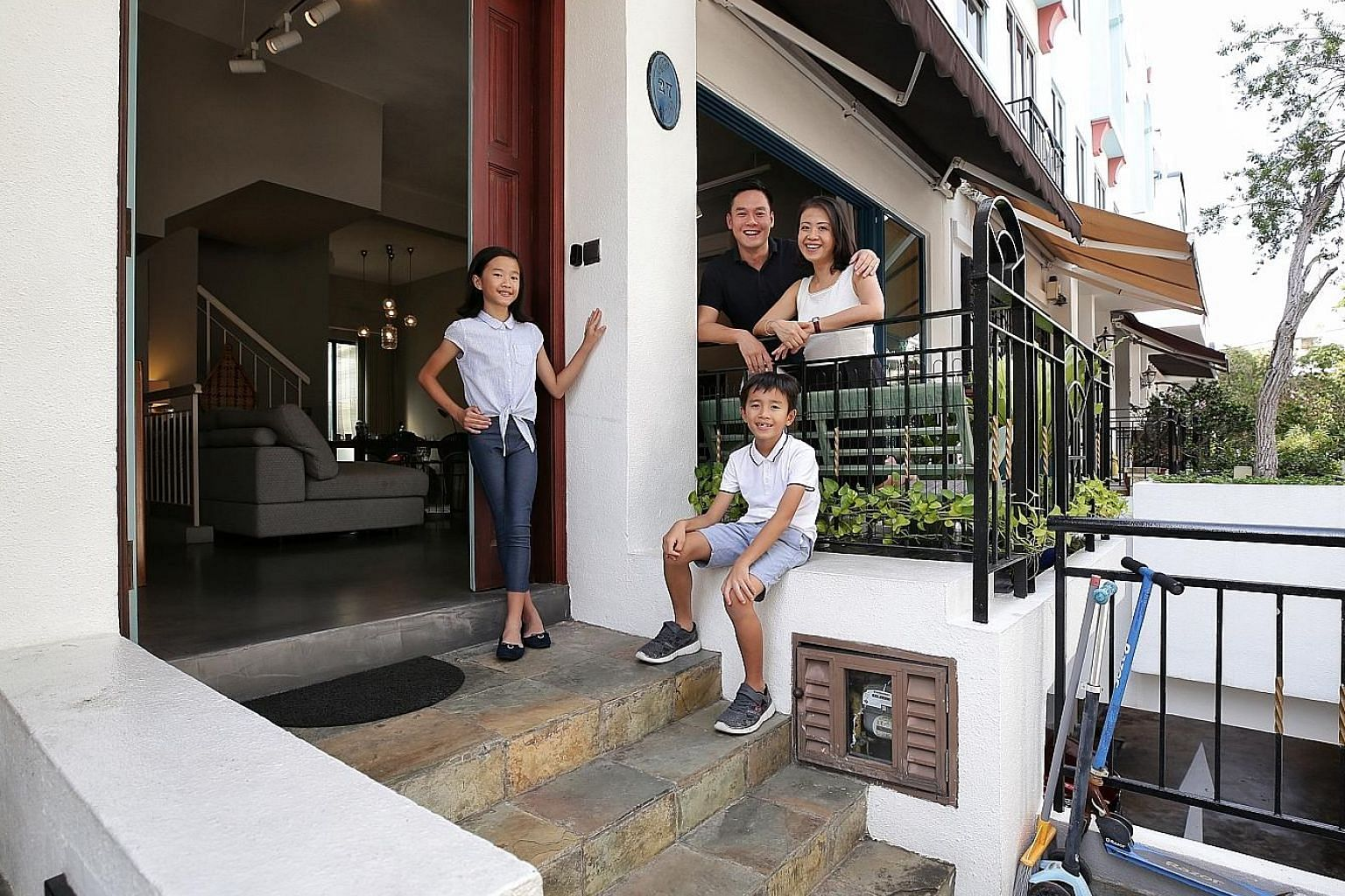 The facade of Ms Pam Chuang's cluster house, which has cross-ventilation with front and back balconies and an unblocked view. ST PHOTO: KEVIN LIM Ms Pam Chuang, vice-president of sales and partnerships at GoBear, and her husband Ivan Lee, with their