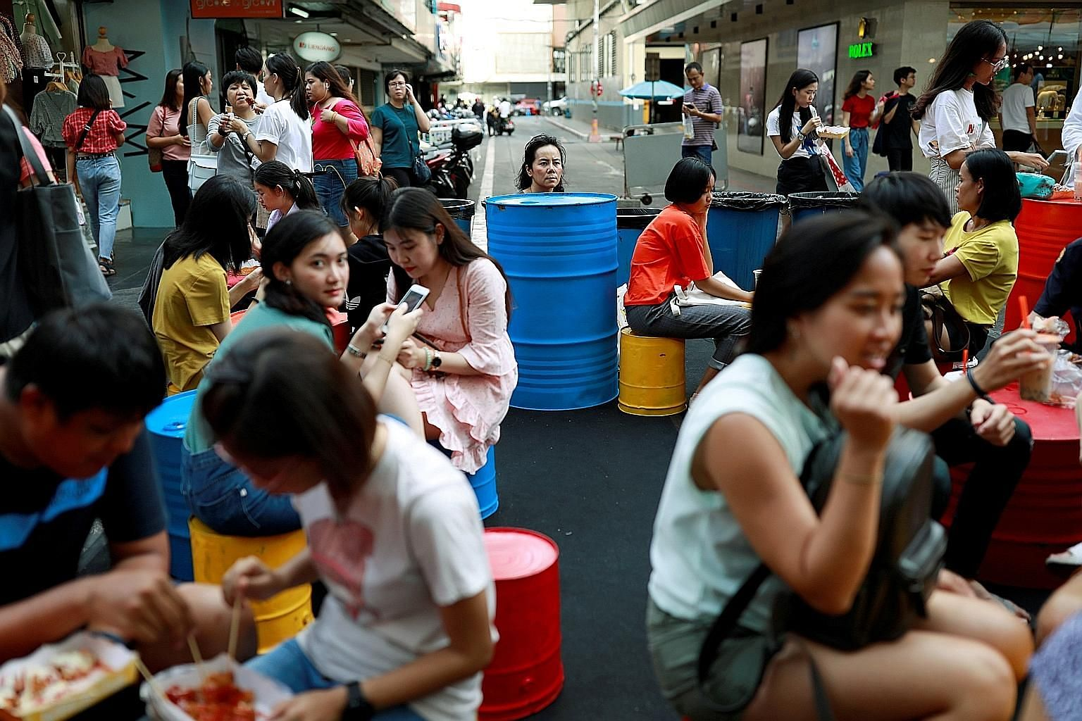 A street market in Bangkok. A stimulus plan launched by Thailand's government aims to get citizens to help boost the flagging tourist industry.