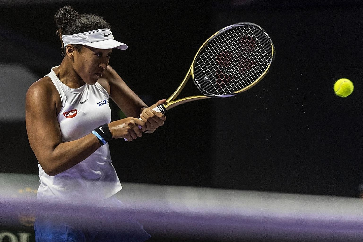 Naomi Osaka returning to Petra Kvitova in the opening match of the WTA Finals in Shenzhen. After recent titles in Osaka and Beijing, the in-form Japanese stretched her winning run to 11 matches with a three-set victory.