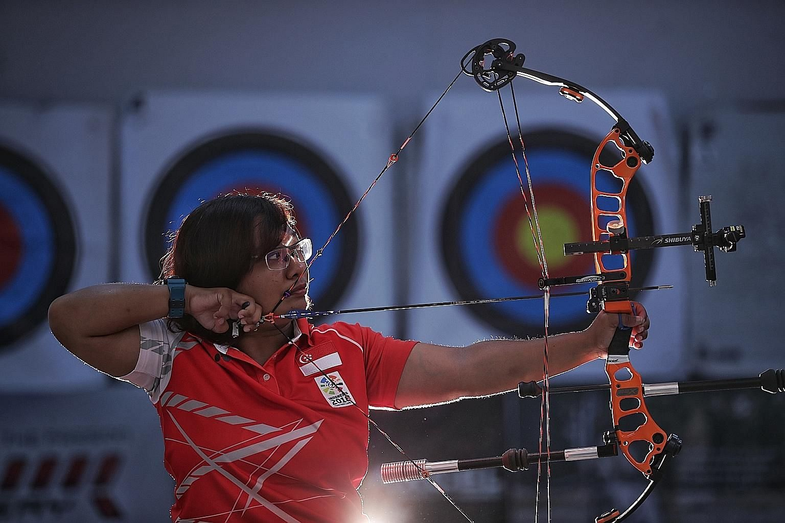 """Para archer Nur Syahidah Alim, ranked the best in the world in her category, has leveraged on sport to build her confidence and become a """"better version of me"""". ST PHOTO: GIN TAY"""