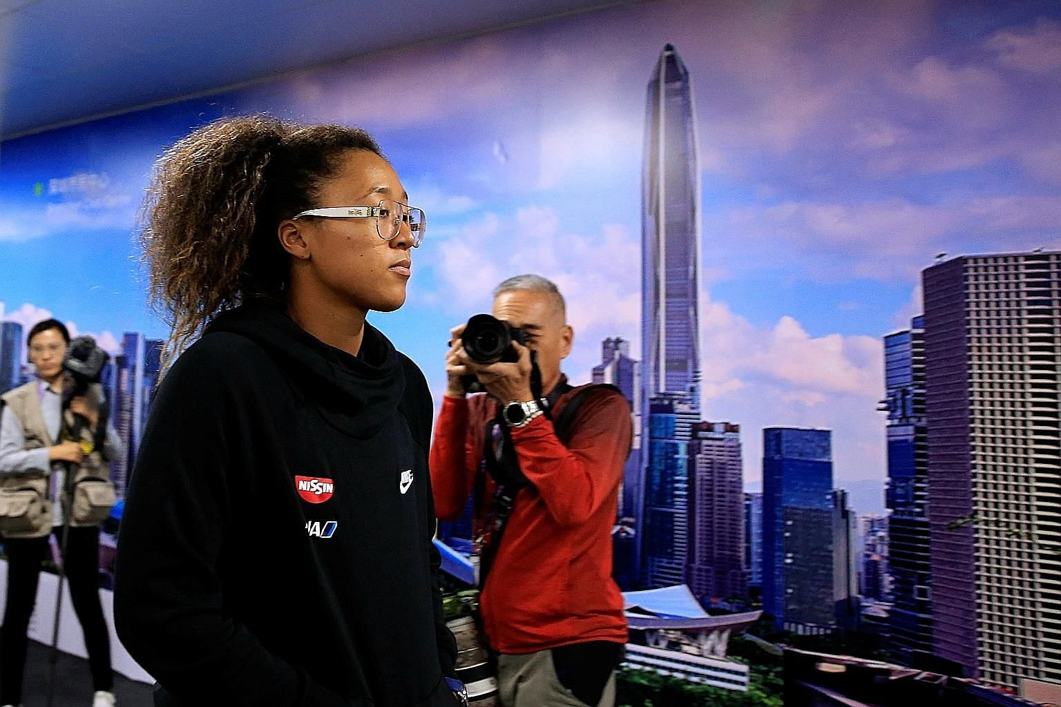 A downcast Japanese star Naomi Osaka leaving after yesterday's news conference. She pulled out of the WTA Finals in Shenzhen with a shoulder injury. Last year, she retired from her final match in the group stage during the tournament in Singapore.