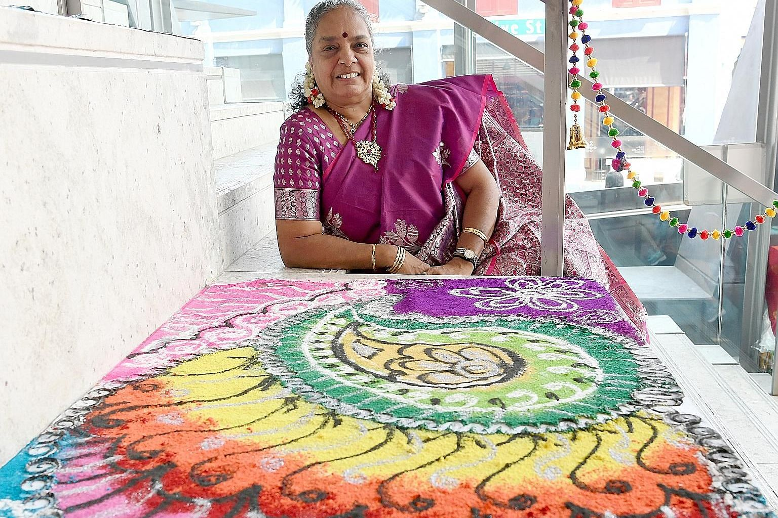 Rangoli artist Vijaya Mohan, 60, plans to apply for The Stewards of Singapore's Intangible Cultural Heritage Award. She has been teaching and creating traditional rangoli designs by hand using powdered rice, coloured sand and innovative materials, su