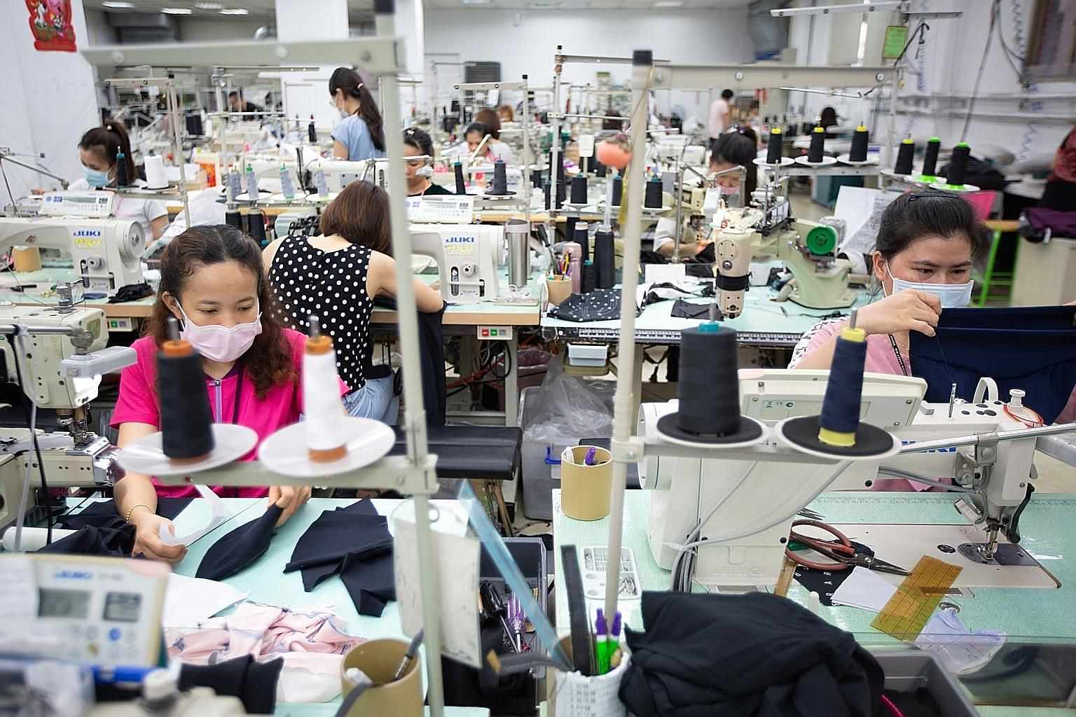 A garment factory in Vietnam. The country stands to gain from the US-China trade war, which has sparked an exodus from China of low value-added production, including textiles. PHOTO: BLOOMBERG