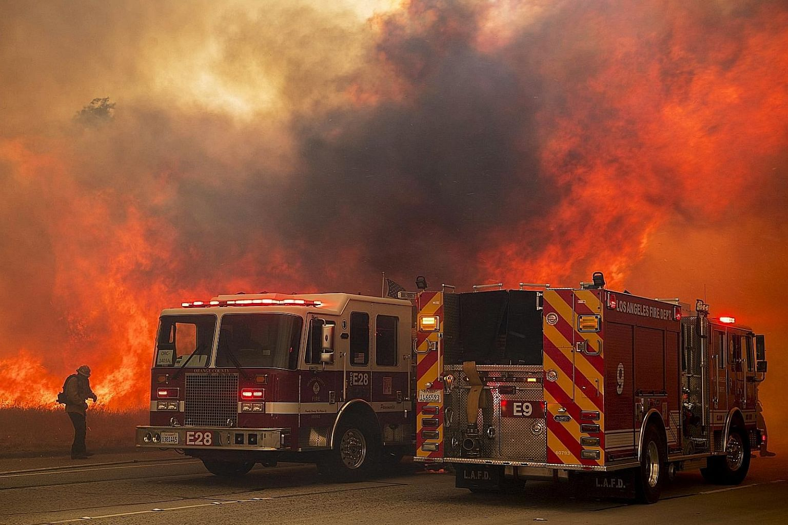 A wildfire erupting in California's Simi Valley on Wednesday. The long-term solutions to many of the state's problems are obvious, says the writer: To stave off fire and housing costs, people should live together more densely, rely less on cars and b
