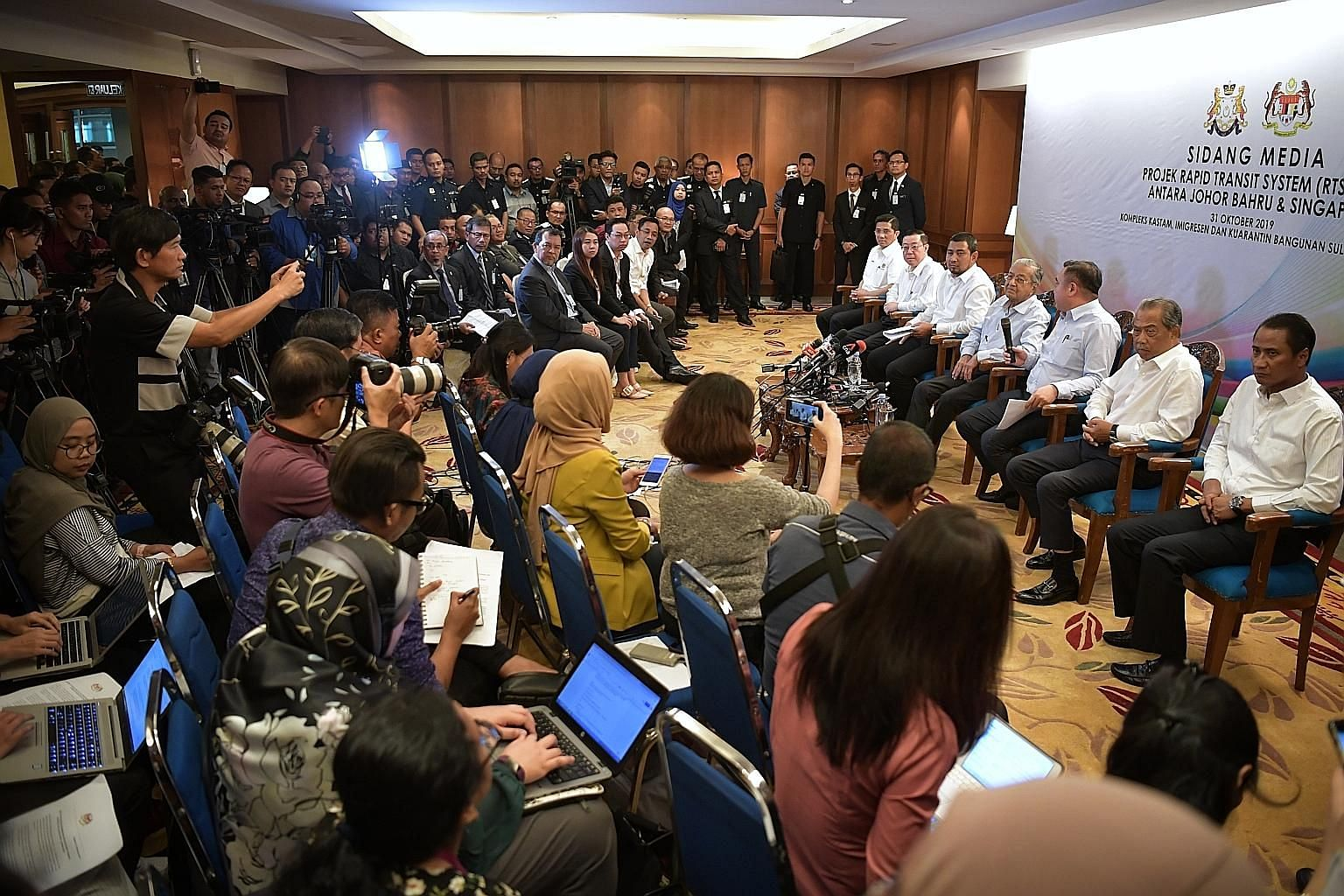 Malaysian Prime Minister Mahathir Mohamad (centre) holding a press conference at the Bangunan Sultan Iskandar Customs, Immigration and Quarantine Complex in Johor Baru yesterday with (from left) Economic Affairs Minister Azmin Ali, Finance Minister L