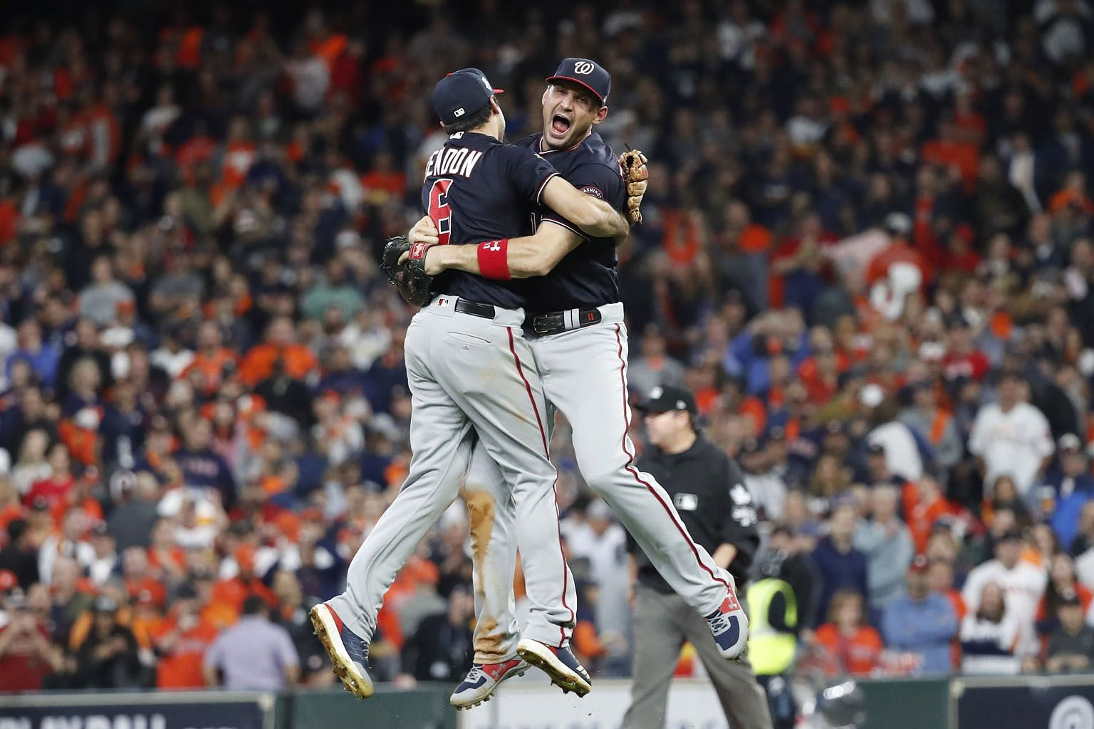 Washington Nationals players Anthony Rendon (left) and Ryan Zimmerman leaping in celebration after defeating the Houston Astros 6-2 in Game 7 of the MLB World Series in Houston, Texas. PHOTO: EPA-EFE