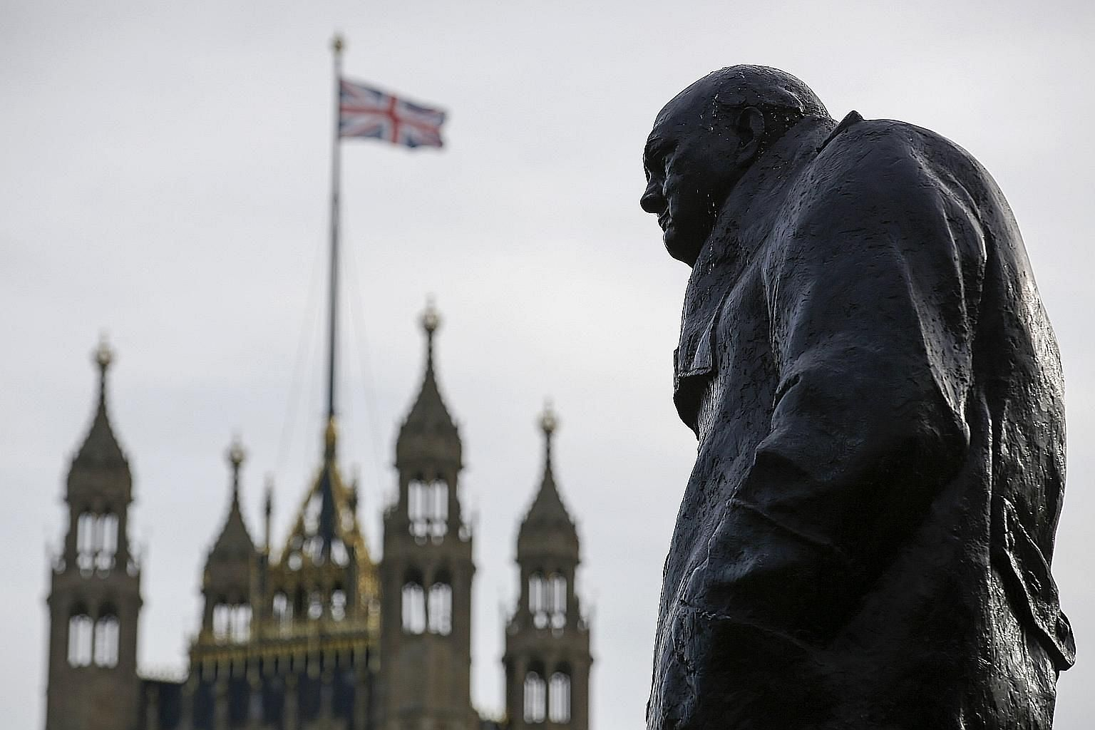A statue of former British prime minister Winston Churchill near the Houses of Parliament in London. The writer says that under a hung Parliament, the United Kingdom could negotiate a new deal on Brexit and then put it to the people for confirmation.