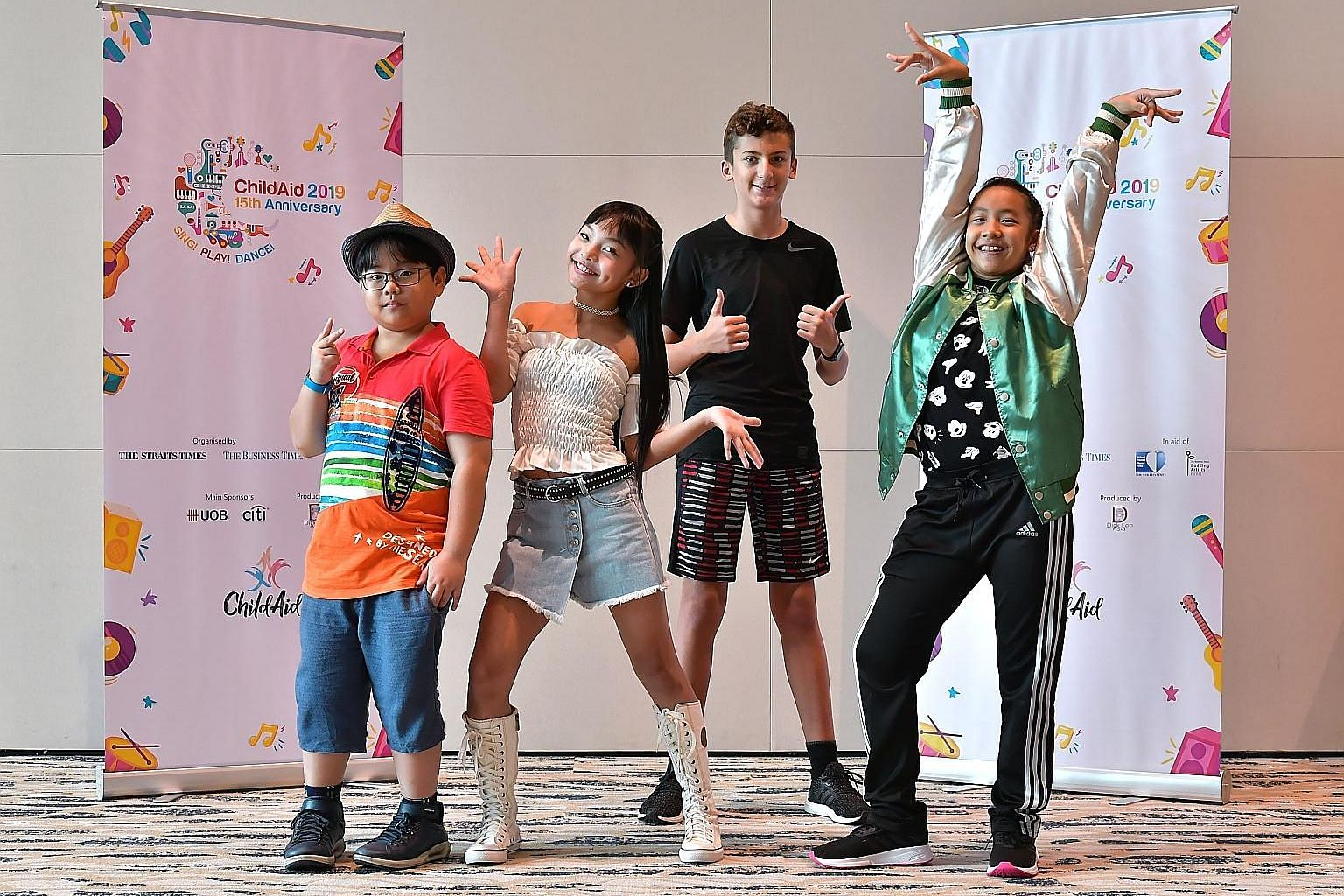 This year's ChildAid concert emcees are (from left) Rey Phua, 11; Gisele Chiam, 10; Steven Simopoulos, 12; and Sri Qaseh Nuraisyah Abdullah, 12. The charity event will showcase young performers using their talents to raise funds for needy students. S