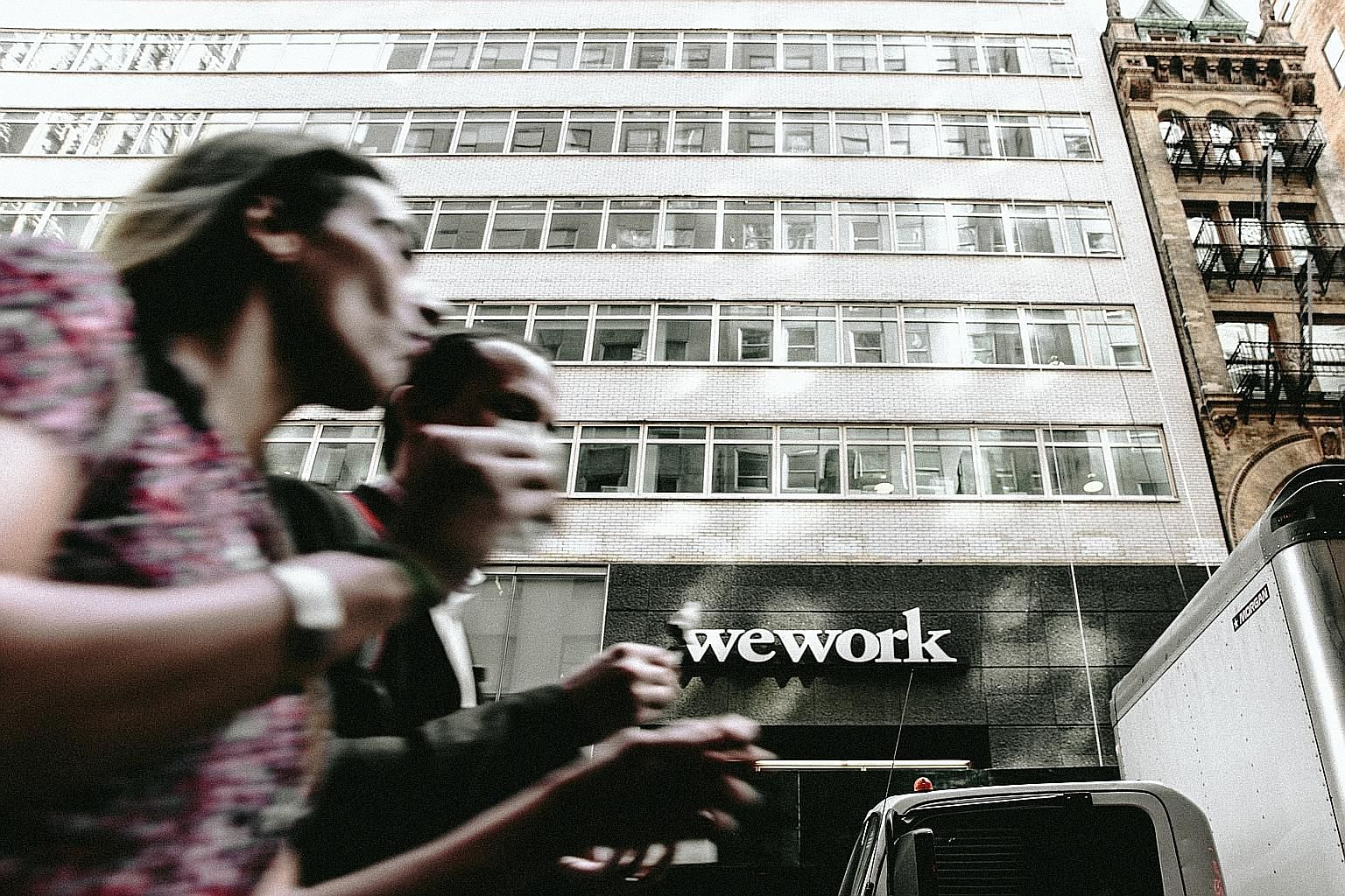 A WeWork location near New York City's Times Square. WeWork was recently reported to be considering a rescue valuation of US$8 billion (S$10.9 billion) following a failed initial public offering, a whopping US$39 billion discount to its last valuation in
