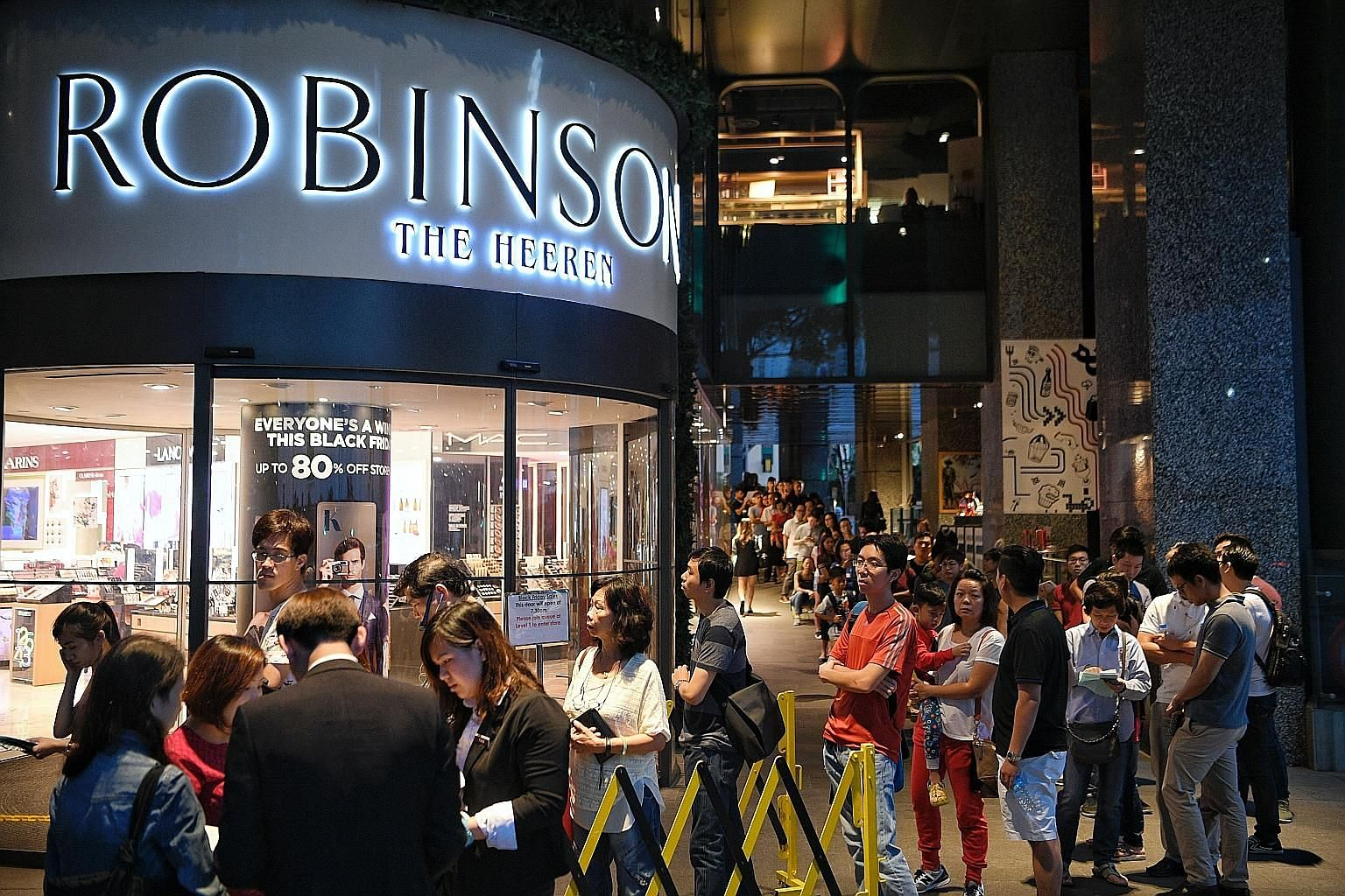 A long queue of people waiting for an Orchard Road department store to open for a major sale. Sales are enticing and attract lots of shoppers because things are generally cheaper. But shoppers should ask themselves whether they really need those prod