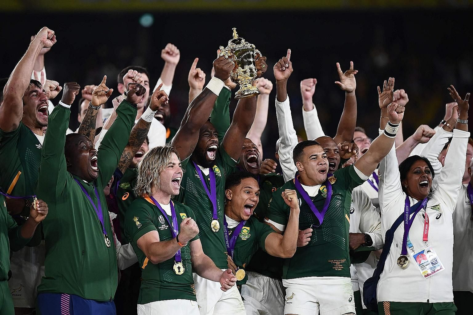 South Africa captain Siya Kolisi lifting the Webb Ellis Cup as they celebrate beating England 32-12 in the Rugby World Cup final at the International Stadium Yokohama yesterday.