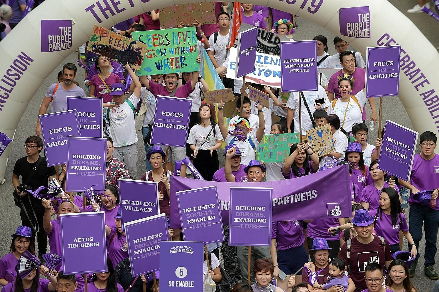 The Purple Parade, an annual event that celebrates the abilities of people with special needs, saw more than 10,000 participants taking part this year at Suntec City. Besides a carnival and a concert, the event also featured dialogues for those with