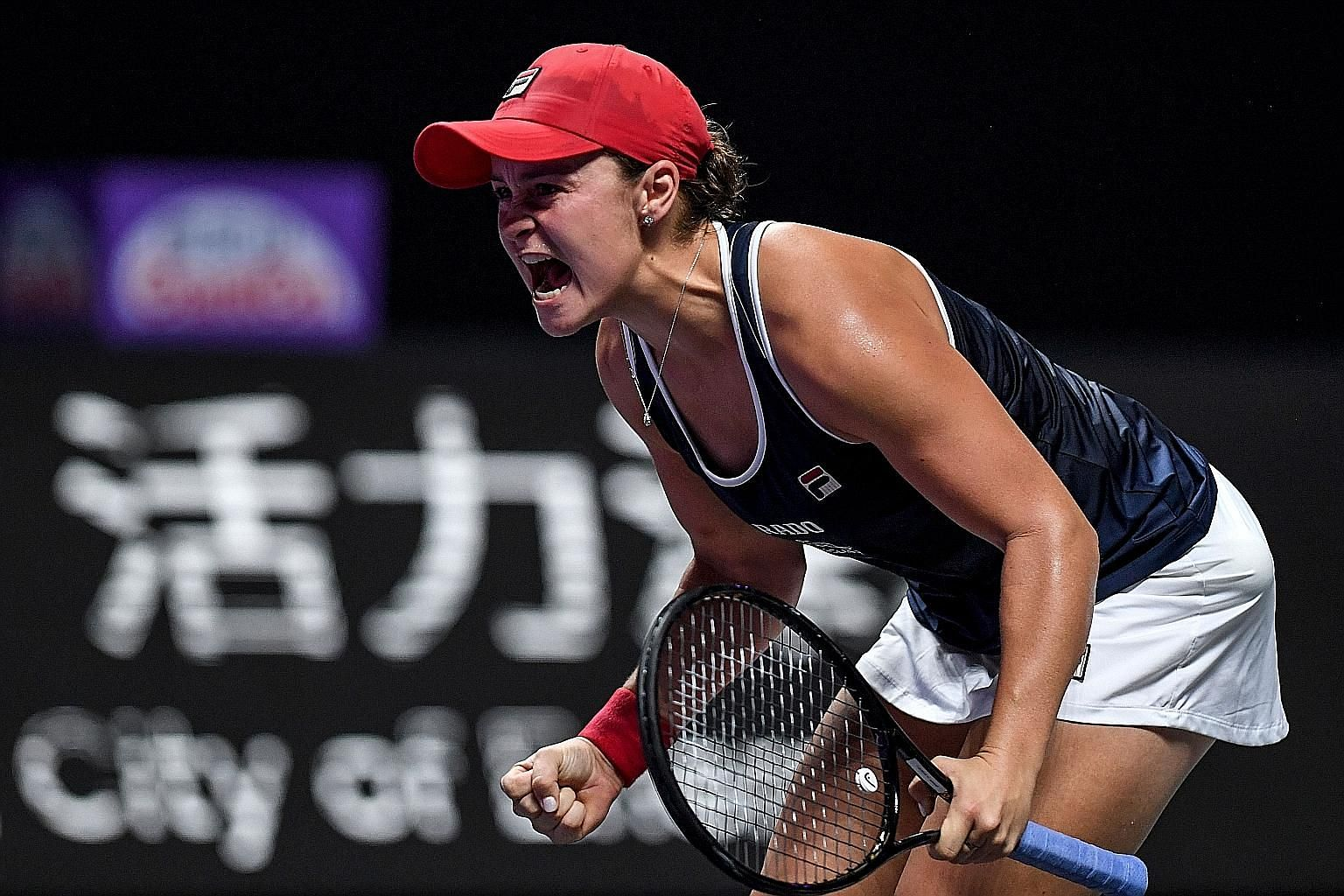 Ashleigh Barty in sheer ecstasy after beating Elina Svitolina of Ukraine 6-4, 6-3 in the final in Shenzhen yesterday. She is the first Australian to win the WTA Finals since Evonne Goolagong Cawley claimed her second title in 1976.