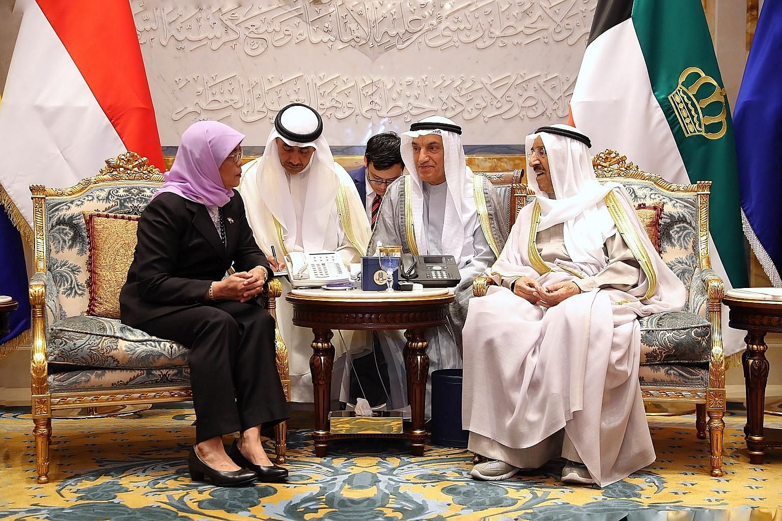 President Halimah Yacob meeting Kuwait Emir Sheikh Sabah Al Ahmad Al Jaber Al Sabah (right) at the country's Bayan Palace yesterday. The two leaders reaffirmed the warm and longstanding friendship between their countries. PHOTO: MCI