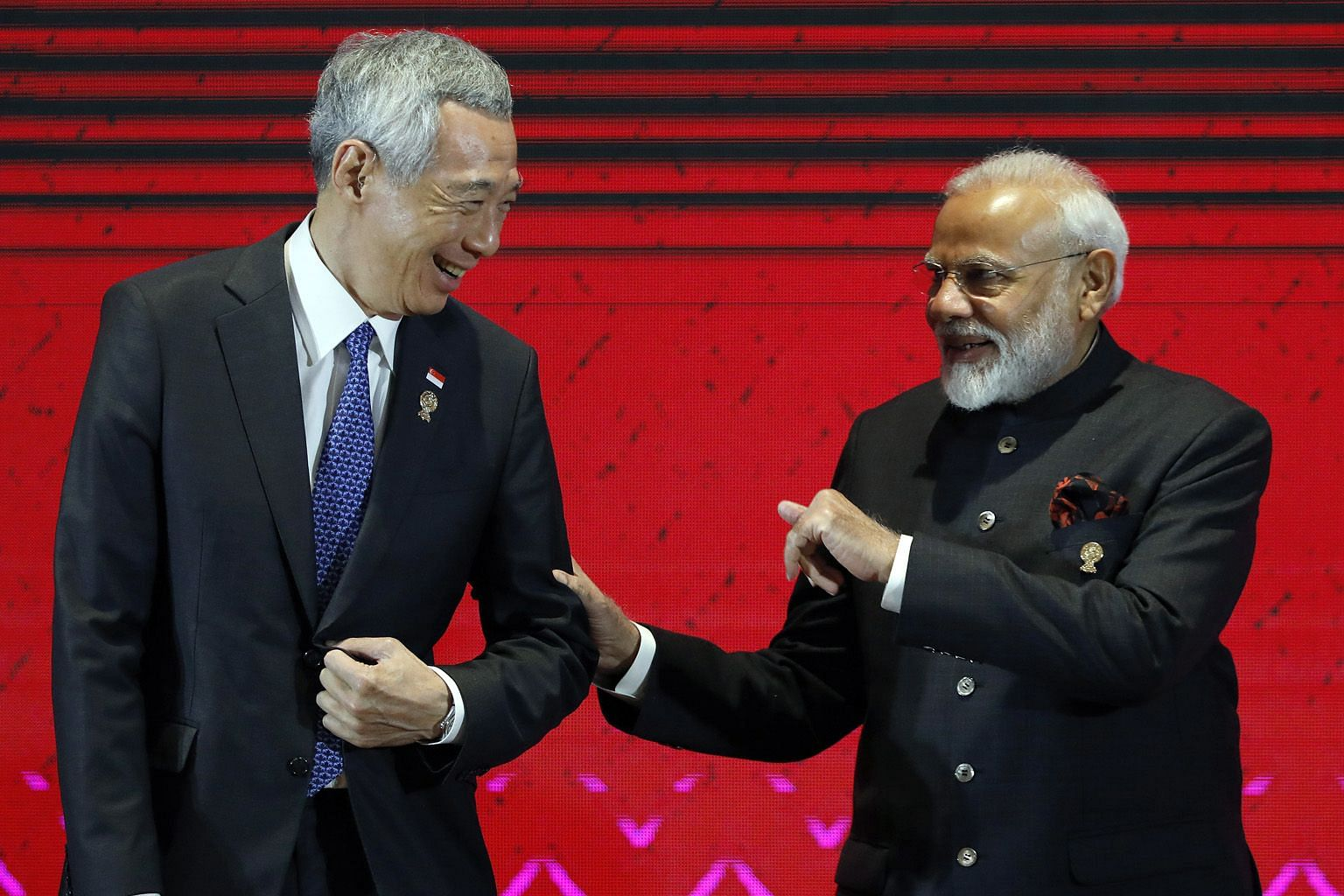 Prime Minister Lee Hsien Loong with Indian PM Narendra Modi at the 16th Asean-India Summit, held as part of the 35th Asean Summit in Nonthaburi province, Thailand, yesterday. The delay in signing the Regional Comprehensive Economic Partnership (RCEP)