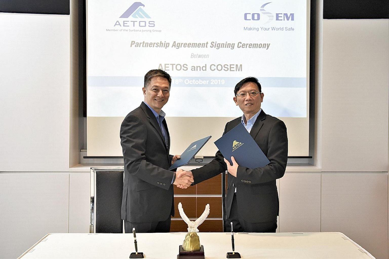 Aetos chief executive Alfred Fox (far left) and Cosem Safety & Security Services chief executive Ng Chee Kiang signed a memorandum of understanding last month. The tie-up between the two firms aims to tackle the manpower crunch in the safety and secu