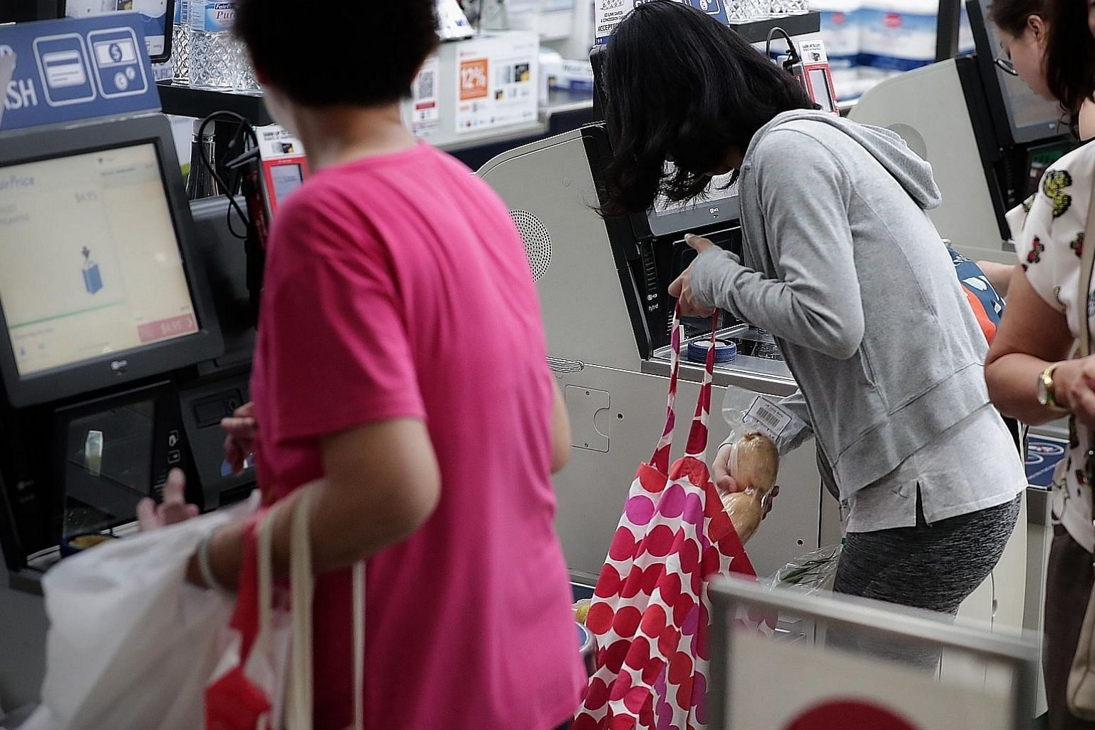 """Under FairPrice's extended """"no plastic bag"""" drive, shoppers are urged to use their own bags. The charge for plastic bags at the outlets involved in the campaign is 10 cents or 20 cents for each transaction."""