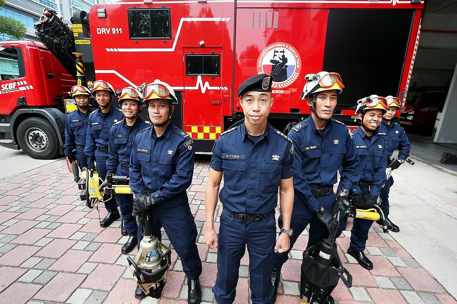 Colonel Chew Keng Tok (in front) led this eight-man Disaster Assistance and Rescue Team, including Sergeant Bahiyudin Abas (third from left) and Warrant Officer Muhammad Himmi Ibrahim (third from right), in a complex 3½-hour rescue mission last Thur