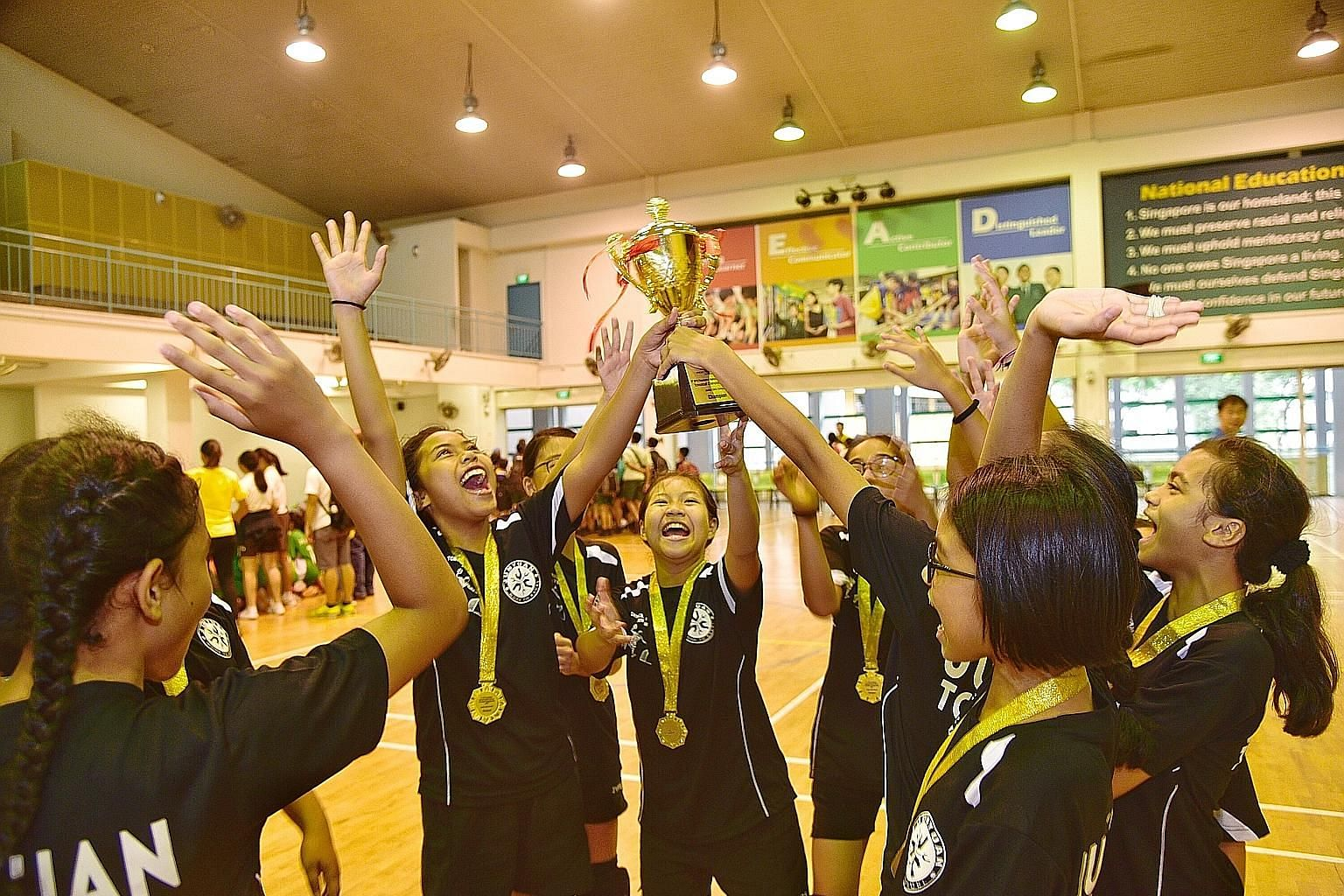 Junyuan Primary School players celebrate after winning the girls' title in the SPH Foundation National Primary Schools Tchoukball Championships yesterday. They recorded six wins and two draws in the round-robin format to emerge champions. The school
