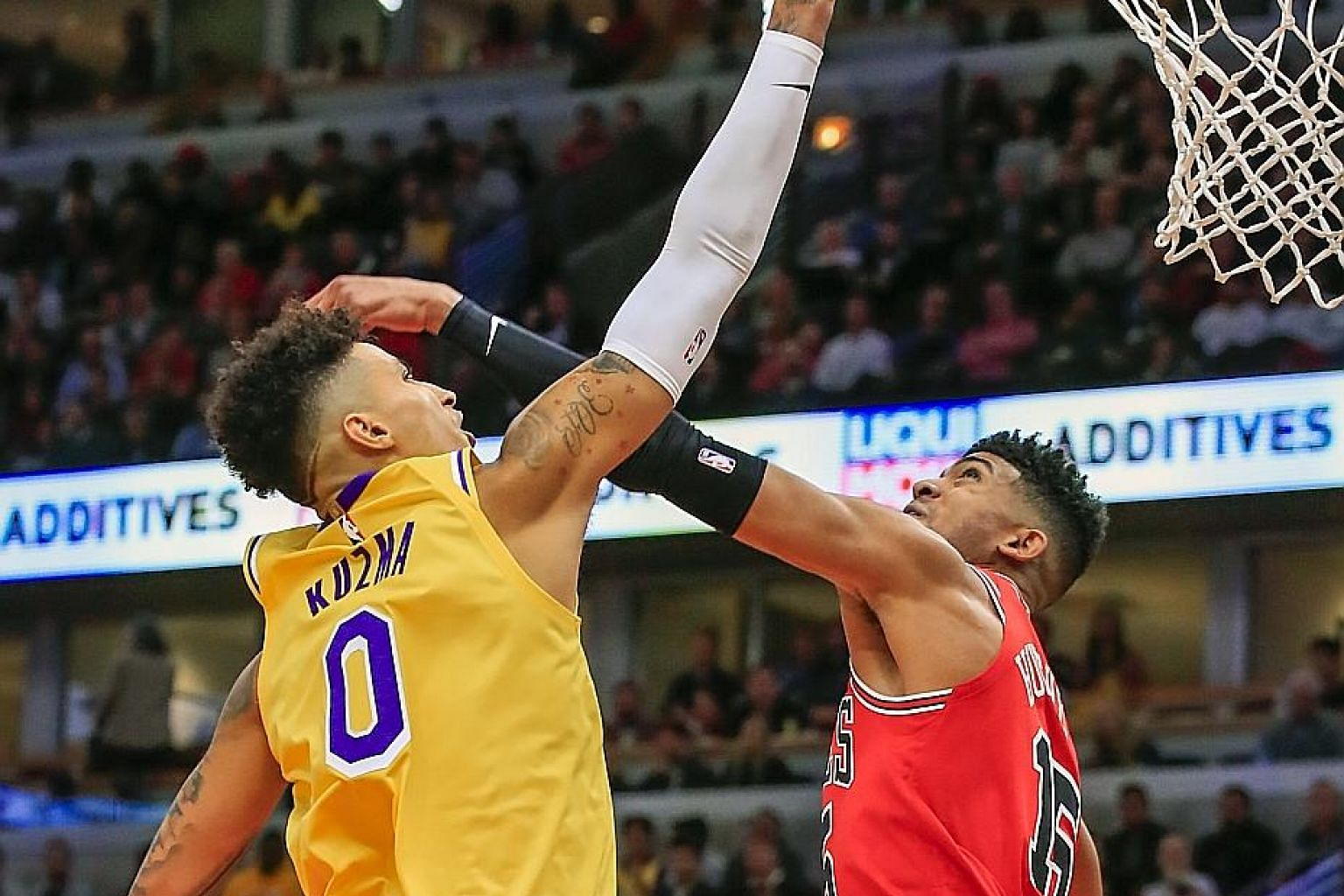 Lakers forward Kyle Kuzma shooting over Chicago Bulls' Chandler Hutchison to score two of his 15 points in their NBA game at the United Centre on Tuesday. Los Angeles' 118-112 win was their third straight away victory.
